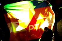 Aug, 2018 - Woman holds banner with party symbol. During a national convention on Saturday, 4, the Workers' Party (PT) officialized the candidacy of former President Lula to run for the presidency of the republic in the October elections. Lula remains in custody at the federal police headquarters in the city of Curitiba since April to serve 12 years and 1 month in prison for corruption and money laundering crimes. (Credit Image: - CJPress/ZUMA Wire/ZUMAPRESS.com)