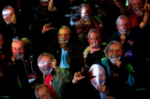 Aug, 2018 - Supporters of former President Lula wear masks with his face. During a national convention on Saturday, 4, the Workers' Party (PT) officialized the candidacy of former President Lula to run for the presidency of the republic in the October elections. Lula remains in custody at the federal police headquarters in the city of Curitiba since April to serve 12 years and 1 month in prison for corruption and money laundering crimes. (Credit Image: - CJPress/ZUMA Wire/ZUMAPRESS.com)