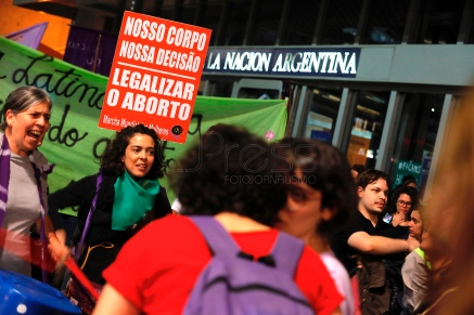 """Sao Paulo, Sao Paulo, Brazil - Aug, 2018 - Protesters gathered this Wednesday (8), in front of the Argentine consulate in the city of Sao Paulo in support of approval of the bill in a vote in the Argentine Senate, which legalizes the practice of abortion in the country. In Brazil the issue is under discussion in the Federal Supreme Court. In the poster the text: """"Our body our decision. Legalize abortion."""" (Credit Image: © Marcelo Chello via ZUMA Wire)"""